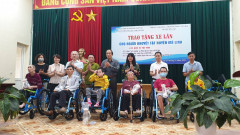 Giving wheelchairs for disable people