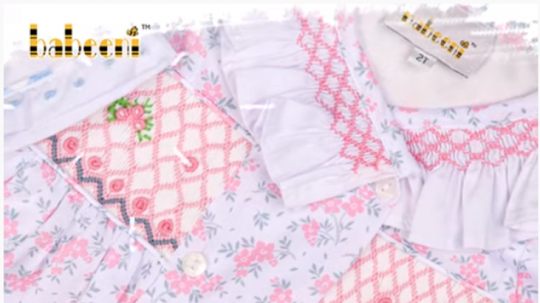 Children clothing with geometric smocked patterns